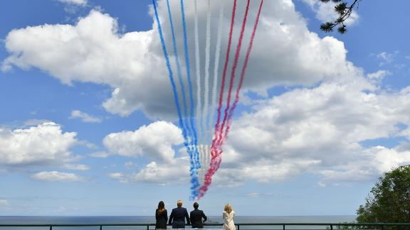 The Trumps are joined by French President Emmanuel Macron and his wife, Brigitte, as they watch a flyover on June 6.
