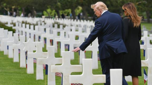 Trump and his wife, Melania, visit the graves of troops who died on D-Day.