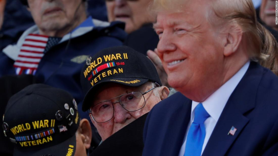 972318fabd8e A World War II veteran looks over Trump's shoulder during the  commemoration