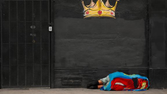 A homeless person sleeps on the sidewalk in Skid Row on June 4.