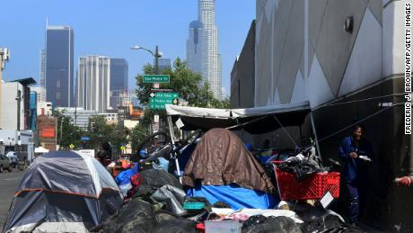 Belongings of the homeless crowd a downtown Los Angeles sidewalk in Skid Row on May 30, 2019. According to new data, homelessness among students is on a rise nationally.