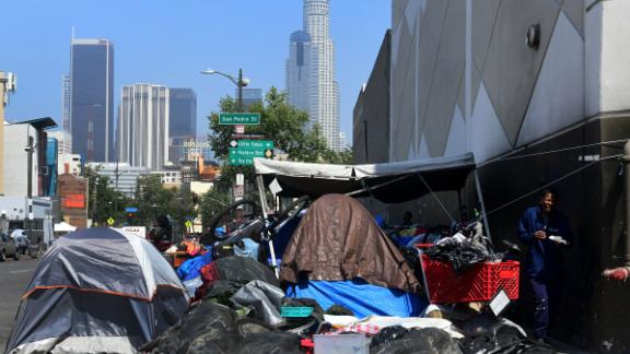 Tents and homeless people's belongings crowd a sidewalk in Skid Row on May 30. The city of Los Angeles agreed on May 29 to allow homeless people on Skid Row to keep their property and not have it seized, providing the items are not too bulky or hazardous.