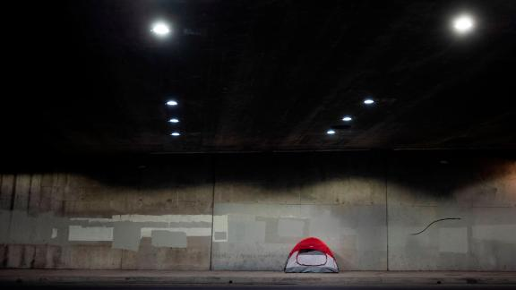 A homeless person's tent is pitched on a sidewalk underneath Interstate 110 on January 3.
