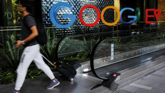 A man passes a Google signage outside its office in Singapore.