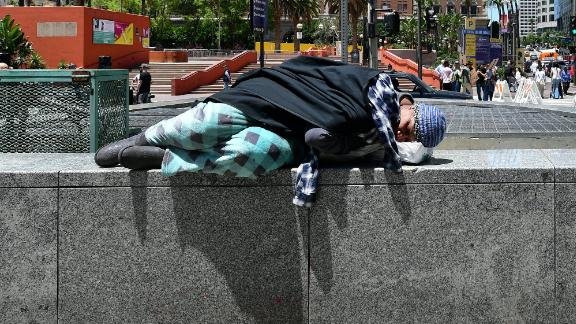 A homeless person sleeps in downtown Los Angeles on May 24.