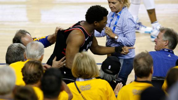 Kyle Lowry yells at Warriors investor Mark Stevens during Game 3 of the NBA Finals in Oakland, California.