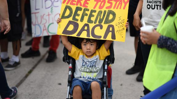 A young boy holds a sign during a protest September 10, 2017 in Los Angeles, California against efforts by the Trump administration to phase out DACA (Deferred Action for Childhood Arrivals), which provides protection from deportation for young immigrants brought into the US illegally by their parents  / AFP PHOTO / Robyn Beck        (Photo credit should read ROBYN BECK/AFP/Getty Images)