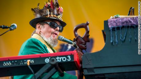 FILE - In this April 30, 2017 file photo, Dr. John performs at the New Orleans Jazz and Heritage Festival in New Orleans. The New Orleans-born musician celebrated his 77th birthday last Nov. 21 in the French Quarter. But he was apparently a year early. Publicist Karen Beninato said she looked into it after talking to friends and relatives of the Rock & Roll Hall of Famer. (Photo by Amy Harris/Invision/AP, File)