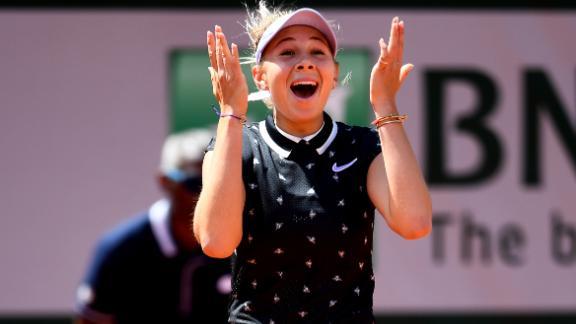 Amanda Anisimova reacts after beating Simona Halep at the French Open.