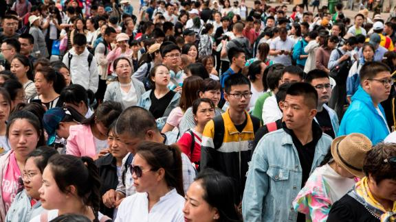 """Students wait for a """"gaokao train"""" at Dayangshu Station in Inner Mongolia on June 5, 2019."""