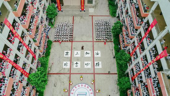 High school students in Huizhou shout words of encouragement on June 5, 2019, ahead of the college entrance exam.