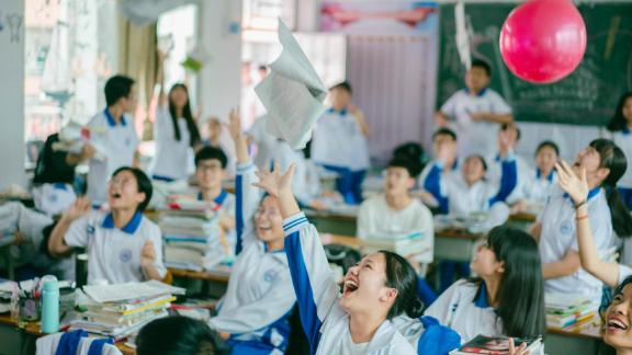 High school students in Huizhou, Guangdong province, throw books into the air on June 5, 2019, ahead of their college entrance exam on June 7.
