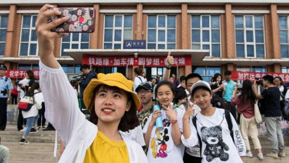 """Students in Dayangshu township in Inner Mongolia on June 5, 2019, as they wait for a """"gaokao train."""" The train operates once a year and takes 450 students from Dayangshu to a town 135 kilometers (84 miles) away where they will sit their college entrance exam."""