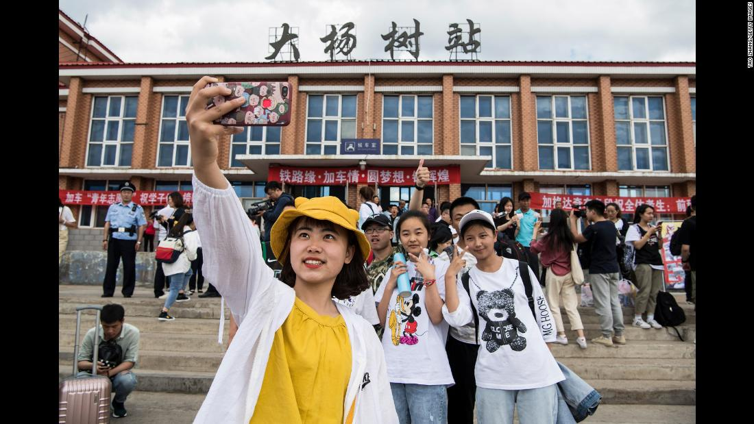 "Students in Dayangshu township in Inner Mongolia on June 5, 2019, as they wait for a ""gaokao train."" The train operates once a year and takes 450 students from Dayangshu to a town 135 kilometers (84 miles) away where they will sit their college entrance exam."