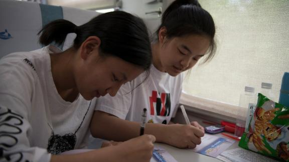 """Students study for their college entrance exam on a """"gaokao train"""" in Inner Mongolia on June 5, 2019."""