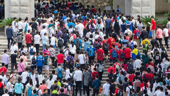 Students enter Nanjing Tin Ka Ping Senior High School, in the eastern city of Nanjing, where they will sit their college entrance exam on June 7, 2019.