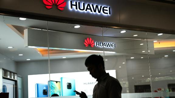 A man walks past a Huawei logo displayed at a retail store in Beijing on May 23, 2019. - Chinese telecom giant Huawei says it could roll out its own operating system for smartphones and laptops in China by the autumn after the United States blacklisted the company, a report said on May 23. (Photo by FRED DUFOUR / AFP)        (Photo credit should read FRED DUFOUR/AFP/Getty Images)