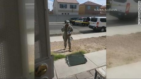 An official from Nellis Air Force Base in Las Vegas examines the plane part, which fell from a craft into a neighborhood nearby.