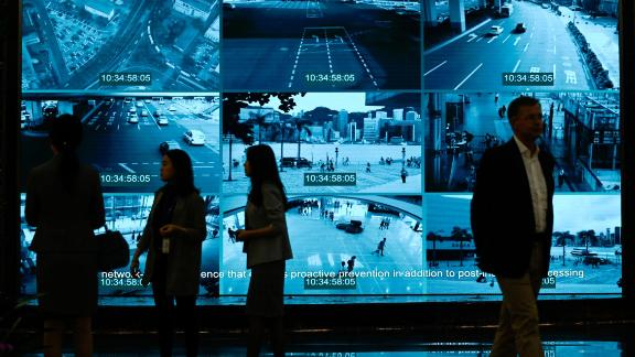 """Journalists visit the Huawei Digital Transformation Showcase in Shenzhen, China's Guangdong province on March 6, 2019. - Chinese telecom giant Huawei insisted on March 6 its products feature no security """"backdoors"""" for the government, as the normally secretive company gave foreign media a peek inside its state-of-the-art facilities. (Photo by WANG ZHAO / AFP)        (Photo credit should read WANG ZHAO/AFP/Getty Images)"""