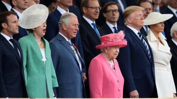 PORTSMOUTH, ENGLAND - JUNE 05:  President of the United States, Donald Trump and First Lady of the United States, Melania Trump stand next to President of the France, Emmanuel Macron (L) British Prime minister, Theresa May, Prince Charles, Prince of Wales and Queen Elizabeth II as they attend the D-Day Commemorations on June 5, 2019 in Portsmouth, England. The political heads of 16 countries involved in World War II joined Her Majesty, The Queen on the UK south coast for a service to commemorate the 75th anniversary of D-Day. Overnight it was announced that all 16 had signed a historic proclamation of peace to ensure the horrors of the Second World War are never repeated. The text has been agreed by Australia, Belgium, Canada, Czech Republic, Denmark, France, Germany, Greece, Luxembourg, Netherlands, Norway, New Zealand, Poland, Slovakia, the United Kingdom and the United States of America. (Photo by Dan Kitwood/Getty Images)
