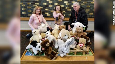 Alex Walker delivers stuffed animals to a Ronald McDonald House in Cleveland.