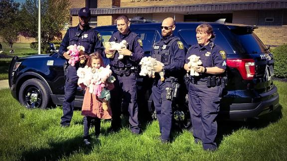Police officers in Euclid, Ohio, accept Alex Walker
