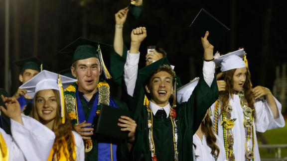 Seniors celebrate at the end of their graduation ceremonies at Paradise High School on Thursday.