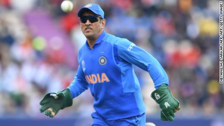 MS Dhoni wearing his wicketkeeping gloves with the army insignia.
