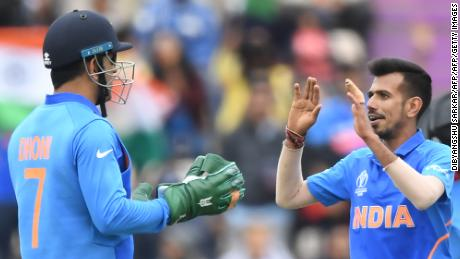 Dhoni celebrates with Yuzvendra Chahal after a wicket against South Africa.
