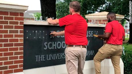 The name of Hugh F. Culverhouse Jr. was removed off a sign in the University of Alabama's School of Law on Friday.