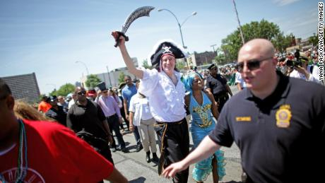 New York City Mayor Bill de Blasio enjoys the nautical festivities with his wife Chirlane McCray in 2014, the same year his children were pronounced mer-king and mer-queen of the parade.