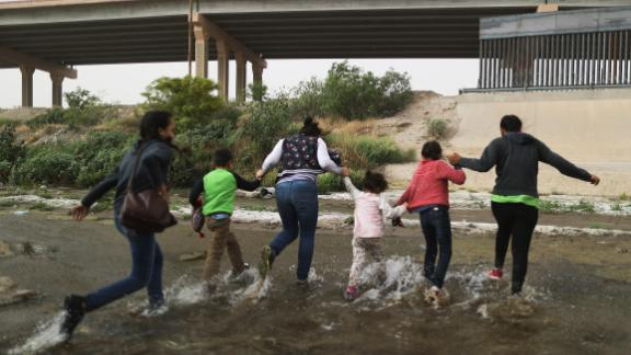 CIUDAD JUAREZ, MEXICO - MAY 20:  Migrants cross the border between the U.S. and Mexico at the Rio Grande river, as they enter El Paso, Texas, on May 20, 2019 as taken from Ciudad Juarez, Mexico. The location is in an area where migrants frequently turn themselves in and ask for asylum in the U.S. after crossing the border.  Approximately 1,000 migrants per day are being released by authorities in the El Paso sector of the U.S.-Mexico border amidst a surge in asylum seekers arriving at the Southern border. (Photo by Mario Tama/Getty Images)
