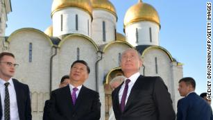 Putin and Xi show a unified front against Trump in St. Petersburg