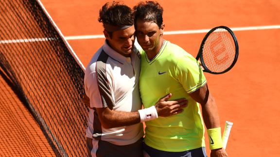Rafael Nadal (right) exchanges a hug with Roger Federer after they played in the French Open semifinals. Who won? Nadal, to improve to 6-0 against the Swiss at Roland Garros.