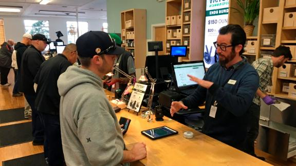Budtender Austin Pitts, right, assists a customer inside the Harborside cannabis dispensary Thursday, Jan. 4, 2018, in Oakland, Calif. Attorney General Jeff Sessions has rescinded an Obama-era policy that paved the way for legalized marijuana to flourish in states across the country, creating new confusion about enforcement and use just three days after a new legalization law went into effect in California. (AP Photo/Terry Chea)