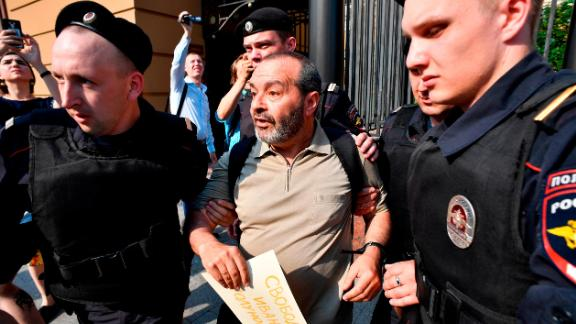 Police officers detain Russian journalist and writer Victor Shenderovich during a rally in support of arrested journalist Ivan Golunov outside the Russian Interior Ministry in Moscow.