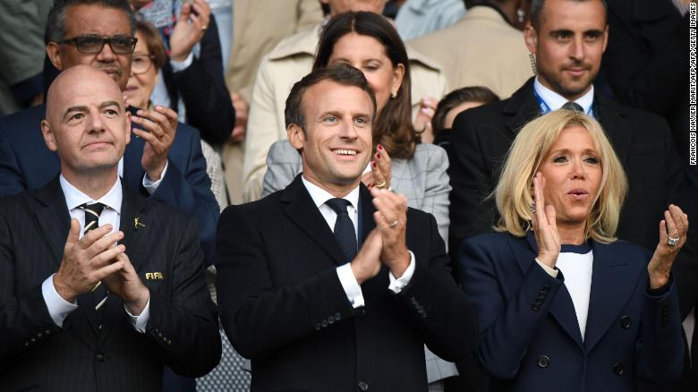 French President Emmanuel Macron and French first lady Brigitte Macron applaud ahead of the start of the Women's World Cup.