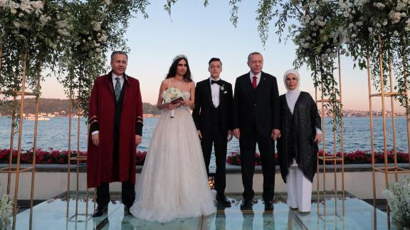 Turkish President Recep Tayyip Erdogan, second from right, and his wife Emine Erdogan attend the wedding ceremony Friday of footballer Mesut Ozil and Amine Gulse, along with the governor of Istanbul Ali Yerlikaya, far left.