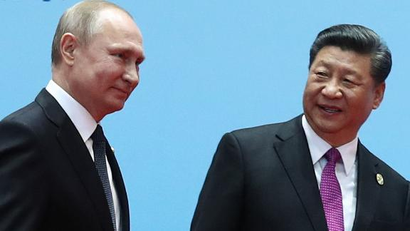 TOPSHOT - China's President Xi Jinping (R) and Russia's President Vladimir Putin smile during the welcoming ceremony on the final day of the Belt and Road Forum in Beijing on April 27, 2019. - Chinese President Xi Jinping urged dozens of world leaders on April 27 to reject protectionism and invited more countries to participate in his global infrastructure project after seeking to ease concerns surrounding the programme. (Photo by Valeriy Sharifulin / Sputnik / AFP)        (Photo credit should read VALERIY SHARIFULIN/AFP/Getty Images)