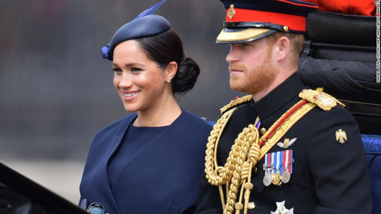 Meghan and Prince Harry make their way in a horse-drawn carriage to Horseguard's Parade ahead of Trooping the Colour.