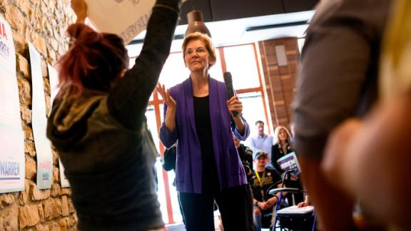 "MASON CITY, IA - MAY 04: Democratic presidential candiate Sen. Elizabeth Warren (D-MA) is interrupted by Kecia Doolittle of Oakland, California during a campaign stop at Fat Hill Brewing on May 4, 2019 in Mason City, Iowa. Doolittle held a sign reading ""Dairy is nothing to be proud of"" while confronting Warren over her co-sponsorship of the Dairy PRIDE Act. (Photo by Stephen Maturen/Getty Images)"