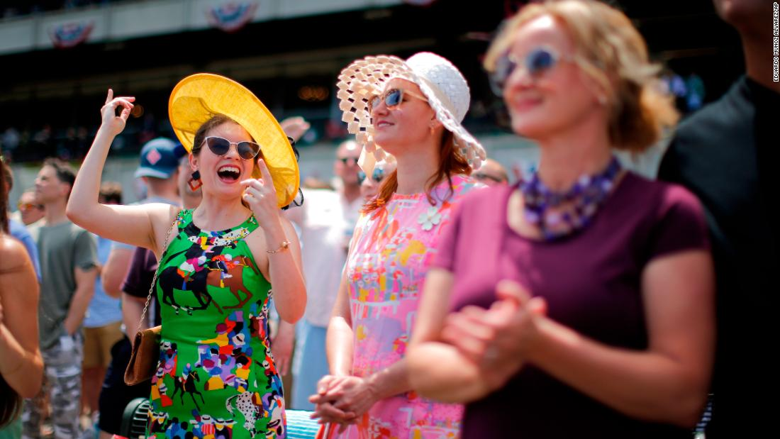 Spectators take in an afternoon race before the Belmont Stakes.
