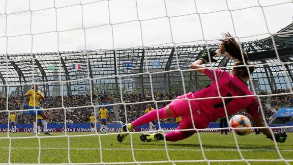 Jamaica's Sydney Schneider blocks a penalty kick from Brazil's Andressa.