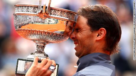 Rafael Nadal lifts the French Open trophy for the 12th time after his four-set victory over Dominic Thiem in Paris.