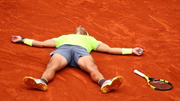 Rafael Nadal sunk to the clay after beating Dominic Thiem to win the French Open.