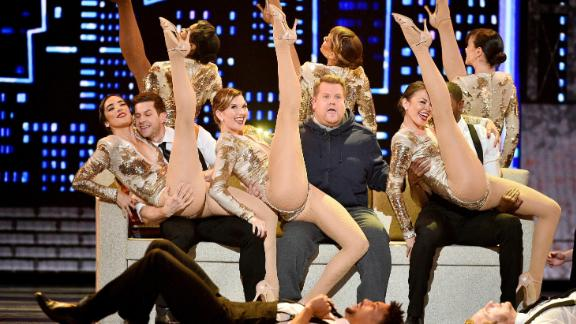 Tonys host James Corden, center, performs during the opening number of the Tony Awards.