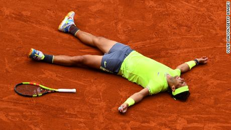Rafael Nadal of Spain celebrates match point following the mens singles final against Dominic Thiem of Austria during Day fifteen of the 2019 French Open at Roland Garros on June 09, 2019, in Paris, France.