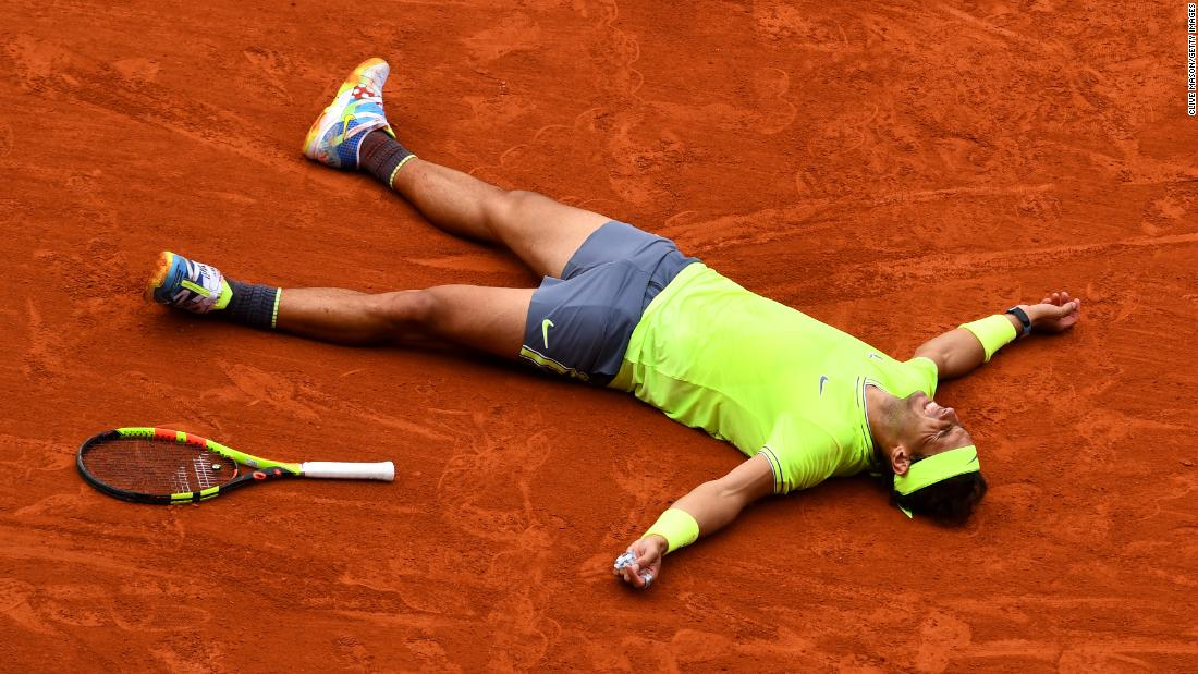 Rafael Nadal of Spain celebrates match point following the men's singles final against Dominic Thiem of Austria during day of 15  of the 2019 French Open at Roland Garros on June 9, 2019 in Paris.