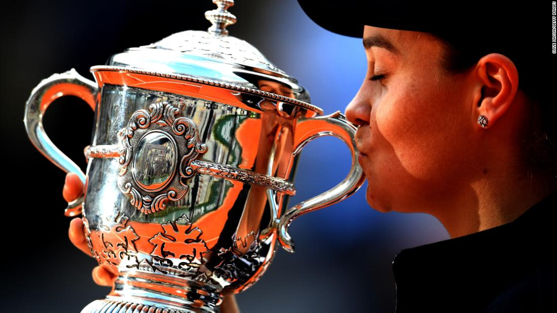 Ashleigh Barty of Australia kisses the trophy as she celebrates victory following the ladies singles final against Marketa Vondrousova of The Czech Republic during day 14 of the 2019 French Open at Roland Garros on June 8, 2019 in Paris.