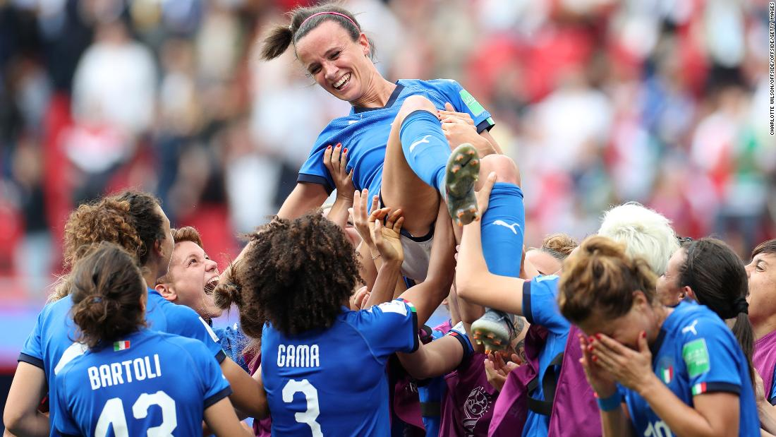 Italy team members lift Barbara Bonansea in the air as they celebrate her winning goal after the final whistle during the 2019 FIFA Women's World Cup France group C match between Australia and Italy at Stade du Hainaut on June 9, 2019 in Valenciennes, France.